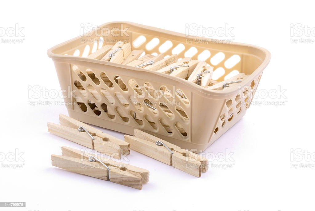 laundry basket and clothes peg stock photo