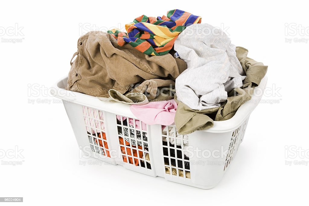 laundry basket and dirty clothing stock photo