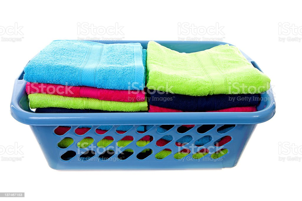 Laundry basket filled with colorful towels stock photo