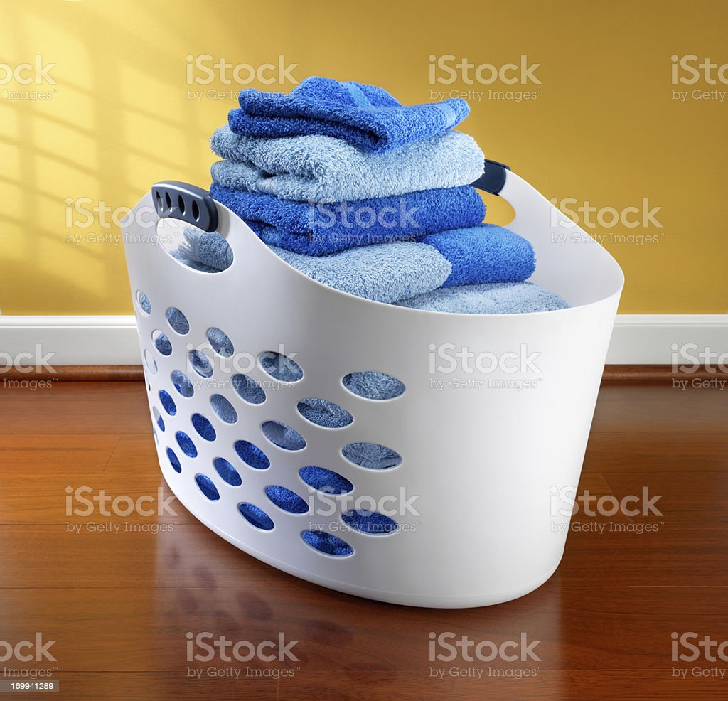 Laundry basket filled with towels royalty-free stock photo