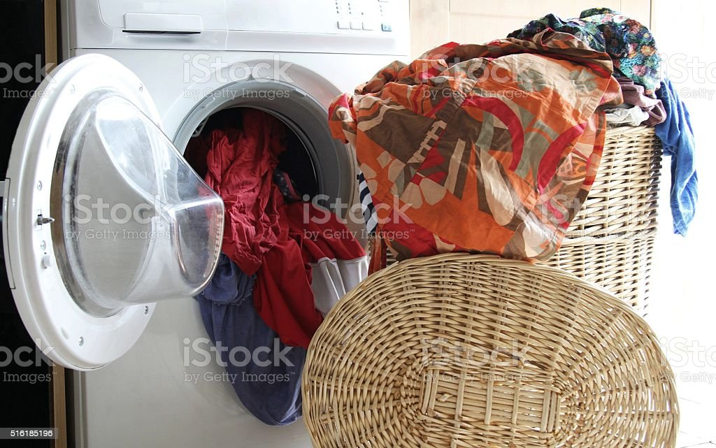 Laundry basket full of clothes, wash day stock photo