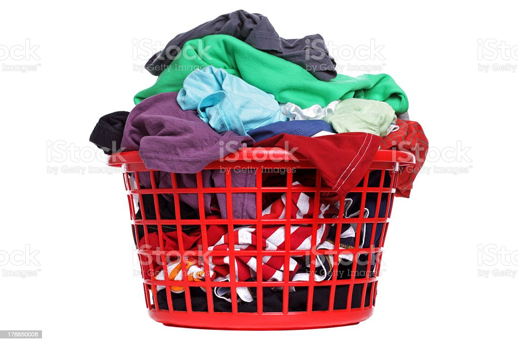 A laundry basket full of multicolored clothes stock photo