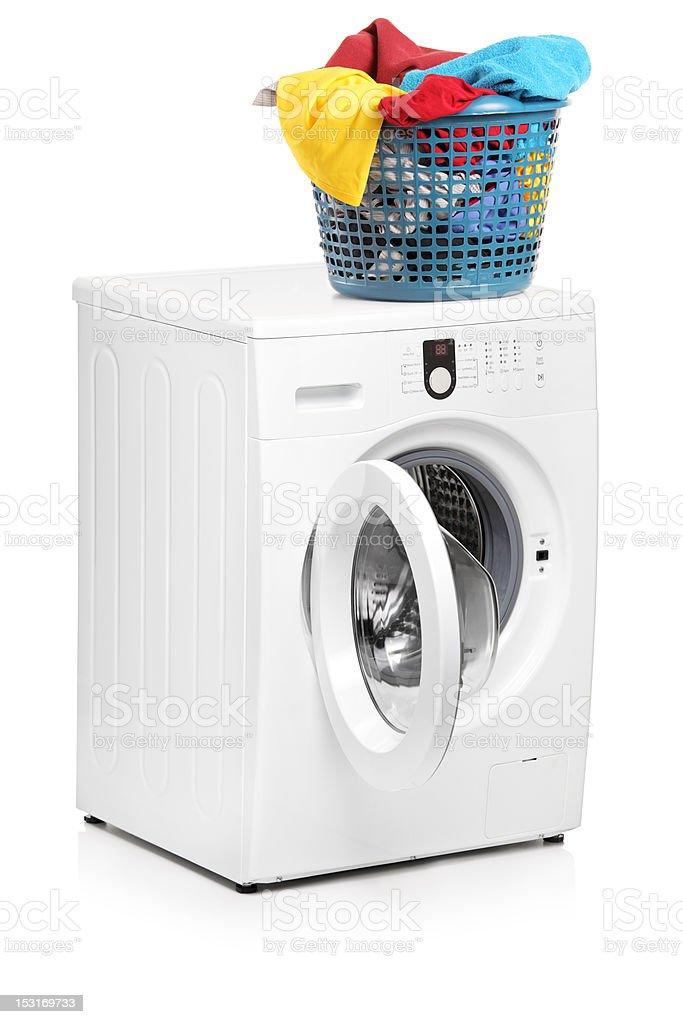 Laundry basket on a washing machine stock photo