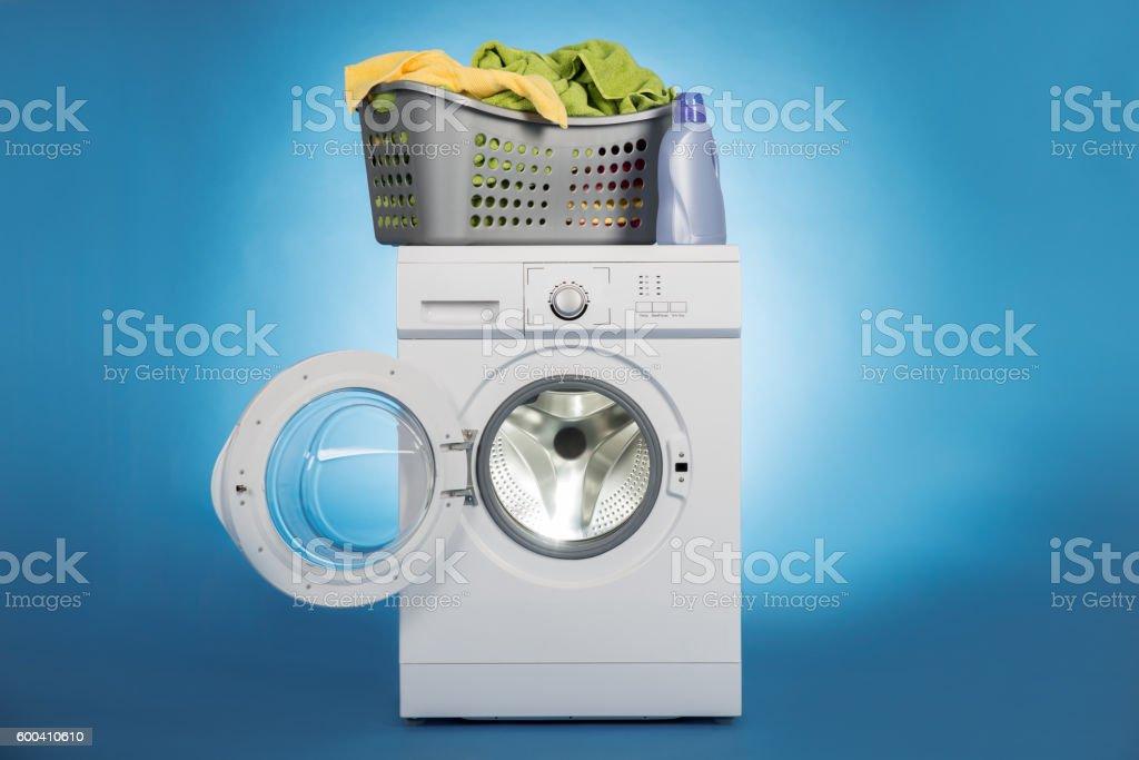 Laundry Basket On Washing Machine stock photo