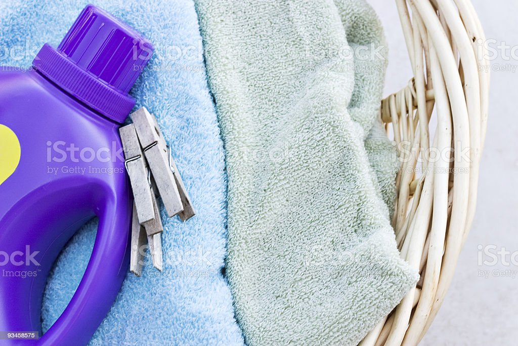 Laundry basket with towels, detergent and clothes pins  stock photo