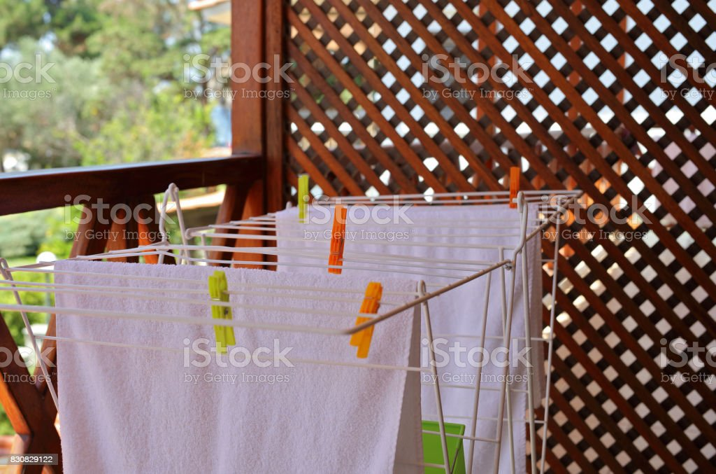 Laundry drying , clean white towels pinned with clothespins stock photo