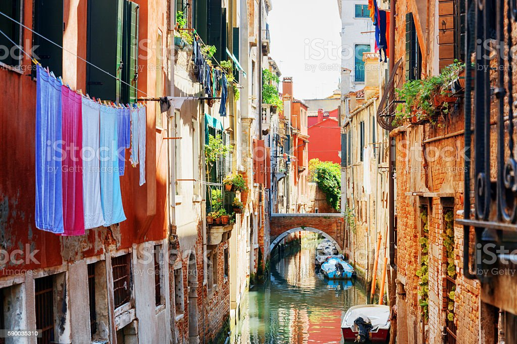 Laundry drying on clothesline above canal of Venice stock photo
