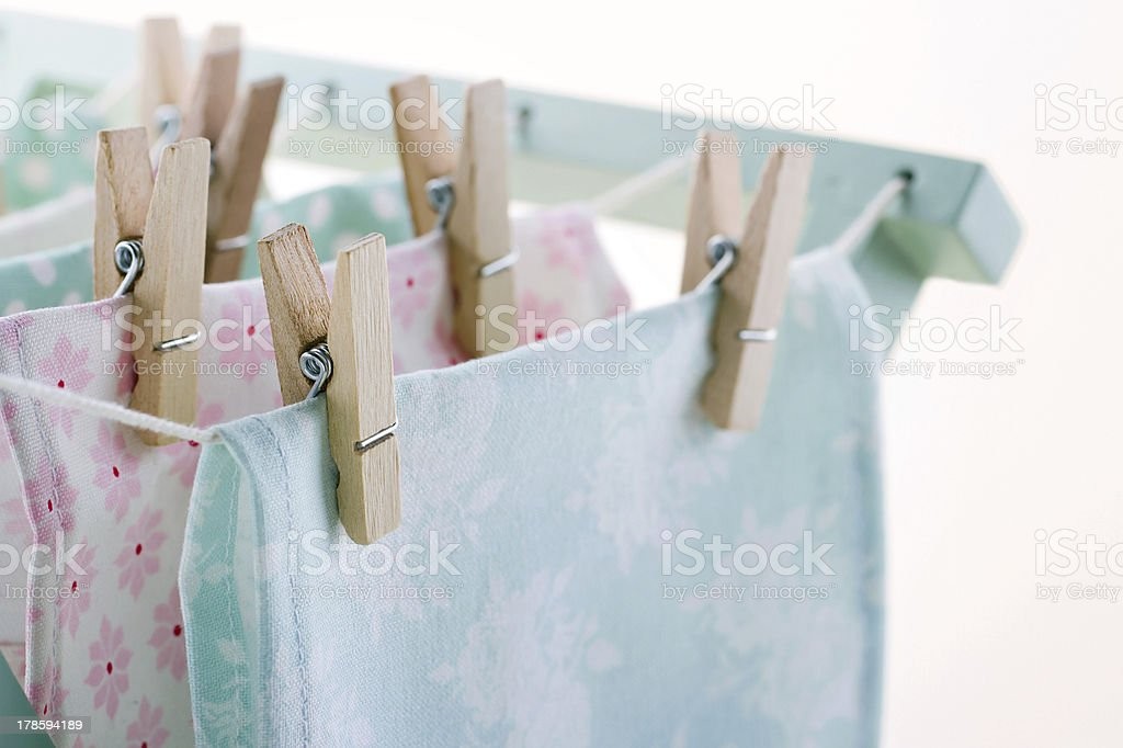 Laundry drying with wooden clothespins stock photo