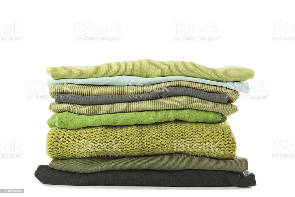Laundry folded up and stacked in a pile stock photo