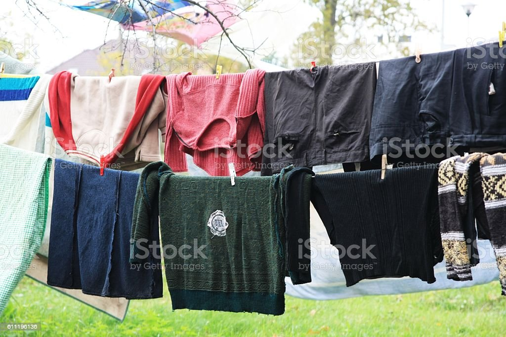 laundry hanging on a clothesline stock photo