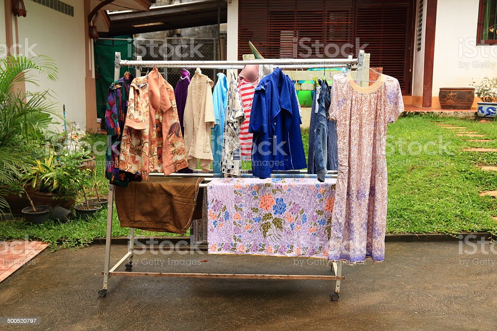 Laundry Hanging out to Dry Outdoors in Rains. stock photo