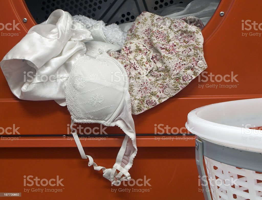 Laundry in a tumbler dryer stock photo