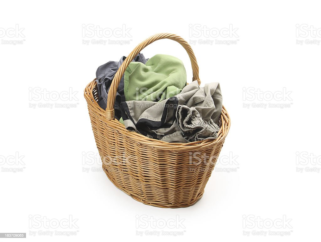 laundry in wicker basket, isolated on white royalty-free stock photo