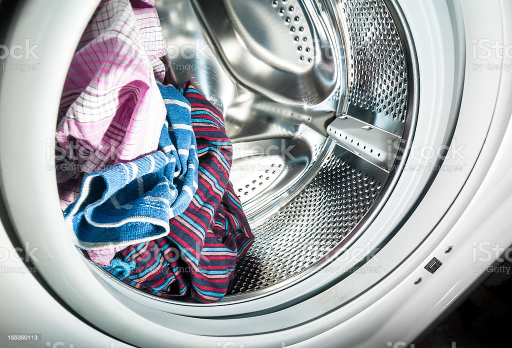 Laundry inside a washing machine drum stock photo