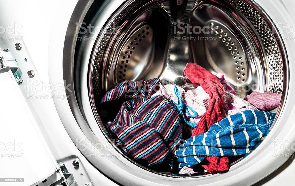 Laundry inside a washing machine drum stock photo