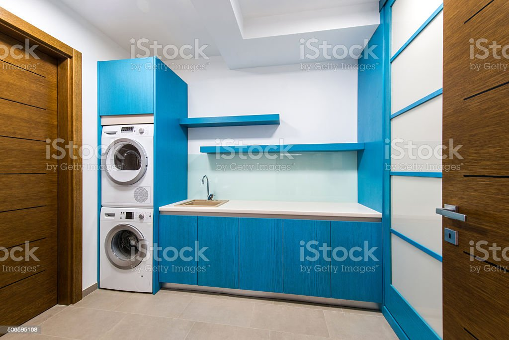 Laundry room in luxury home with large washer and dryer stock photo