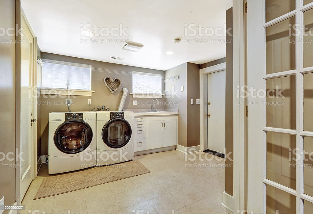 Laundry room interior in grey color stock photo