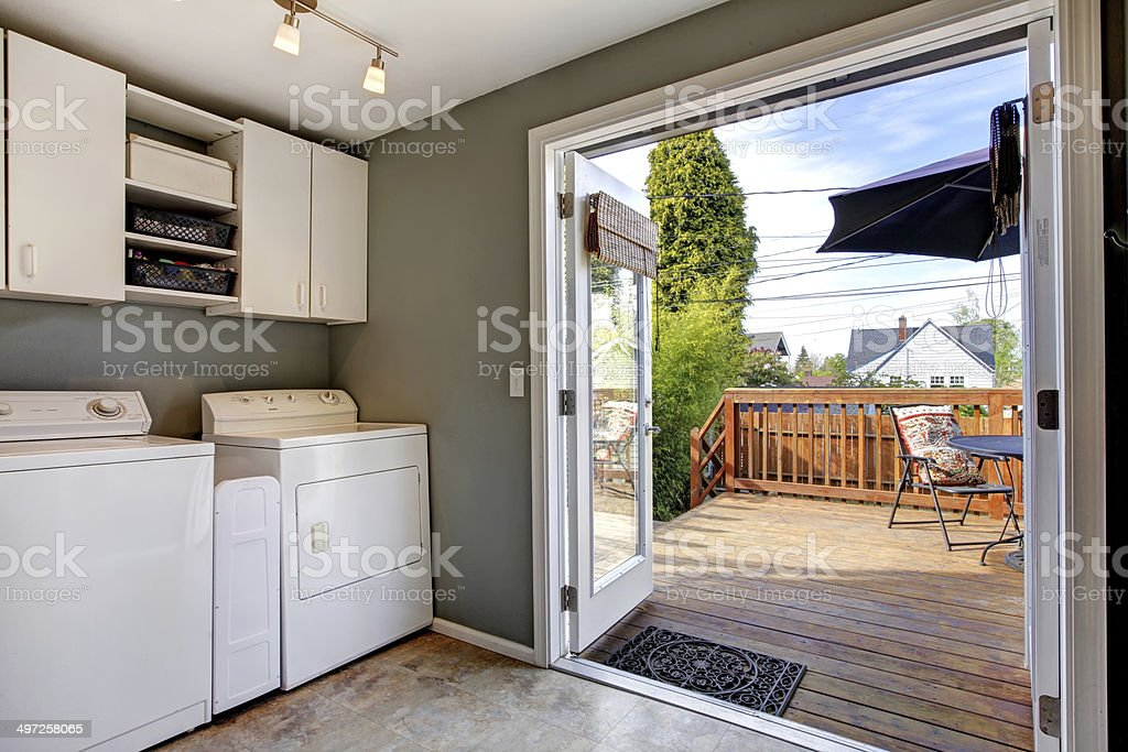 Laundry room with exit to walkout deck stock photo