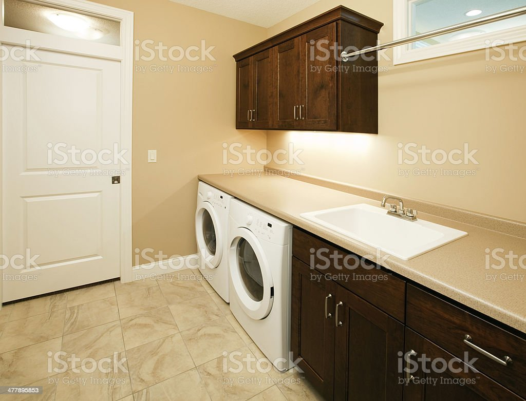 Laundry Room with Front Loading Washer and Dryer stock photo