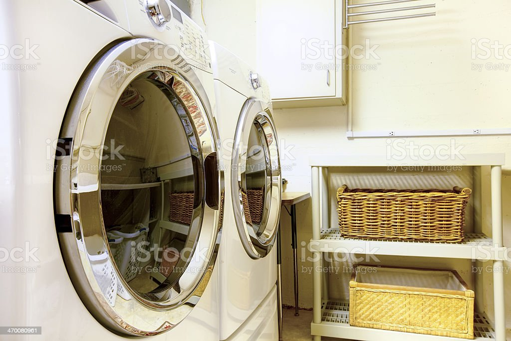 Laundry room with modern appliaces stock photo