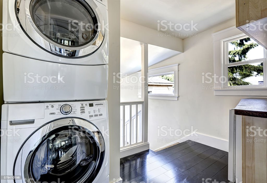 Laundry room with modern white appliances stock photo