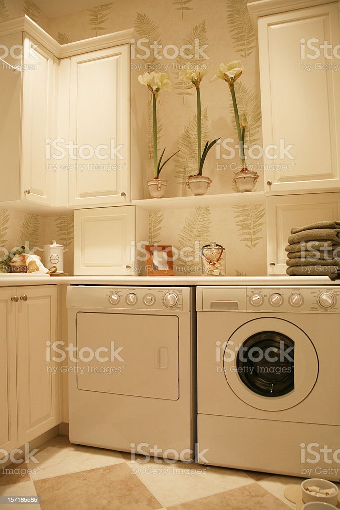 Laundry room with washer and dryer and cabinets royalty-free stock photo