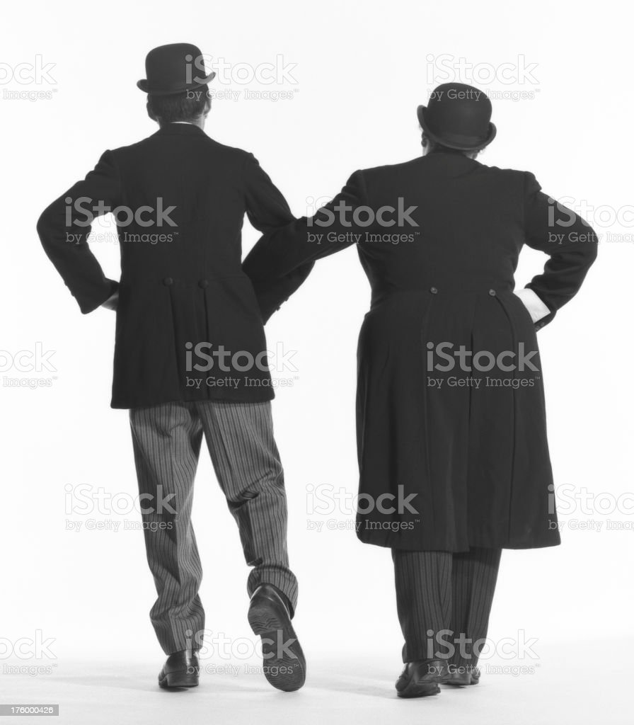 Laurel and Hardy hats on. royalty-free stock photo