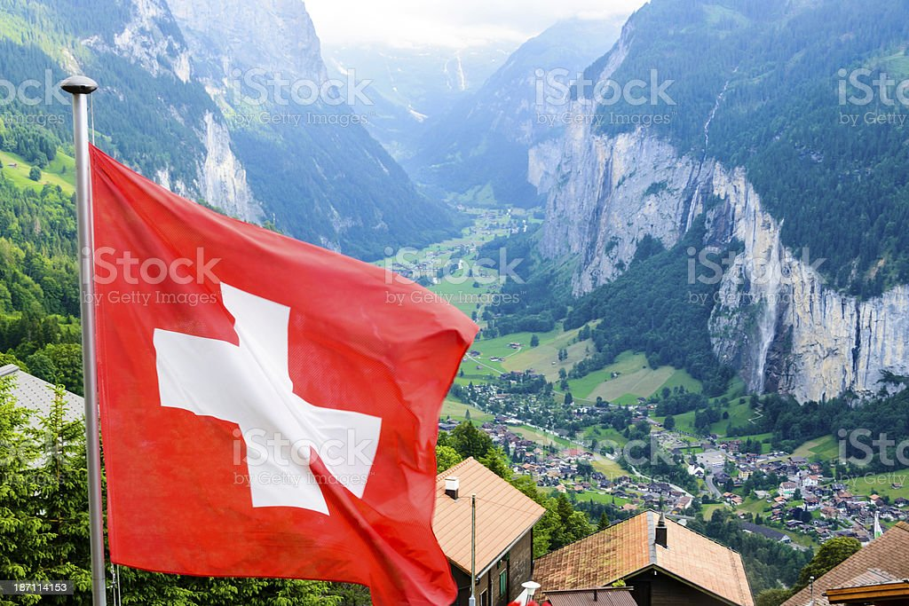 Lauterbrunnen Valley in the Bernese Oberland, Switzerland with Swiss Flag royalty-free stock photo