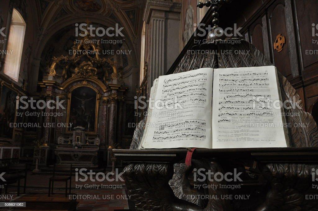 Lautrec, France, midi-Pyrenees area, church interior, hymn book in Latin. stock photo