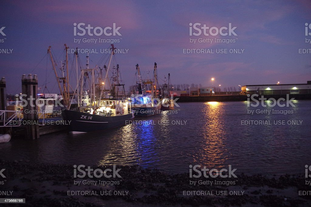 Lauwersoog harbour at sunset stock photo