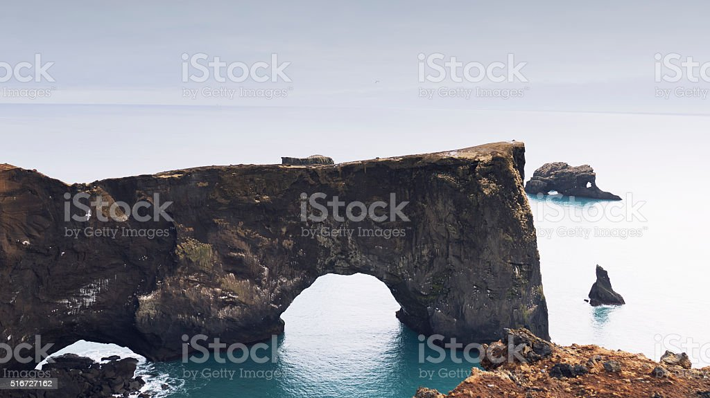 Lava arch with hole at Dyrholaey, Vik,Iceland stock photo