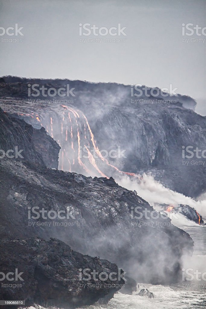 Lava erupting into Pacific Ocean in Hawaii royalty-free stock photo