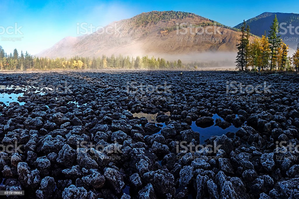 Lava field and morning mist stock photo