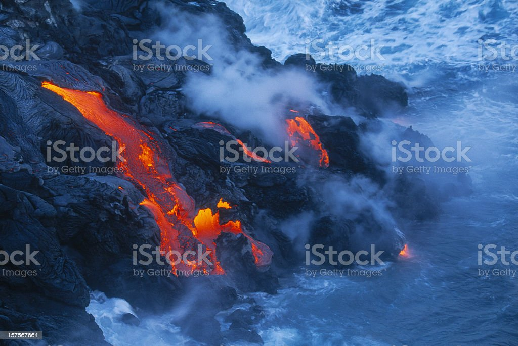 Lava flow in Hawaii flowing into the ocean stock photo