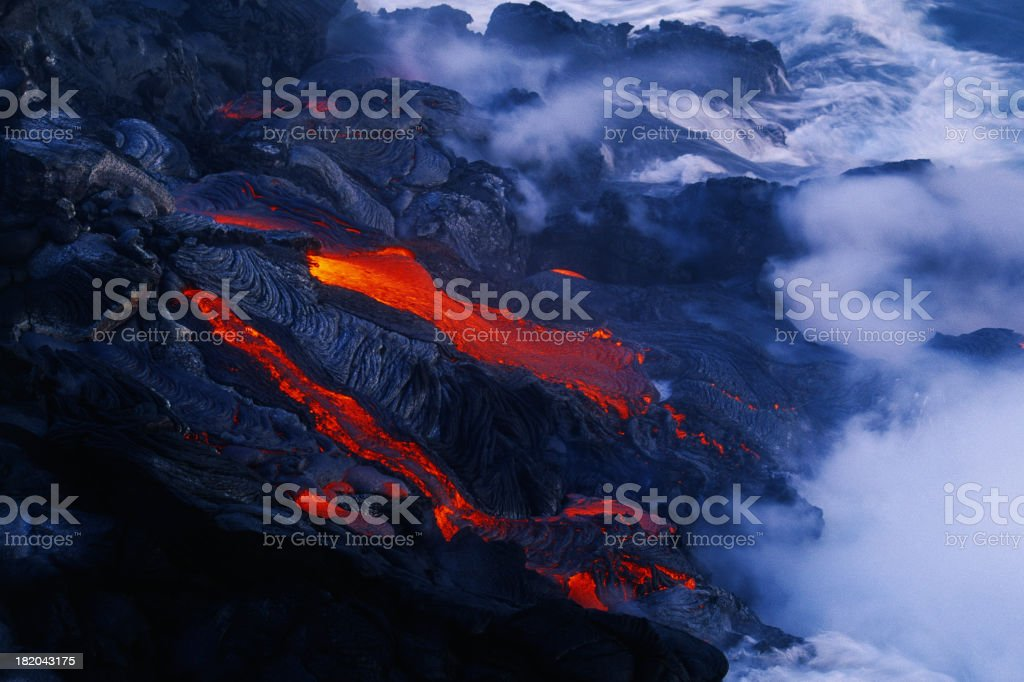 Lava flow in Hawaii flowing into the ocean royalty-free stock photo