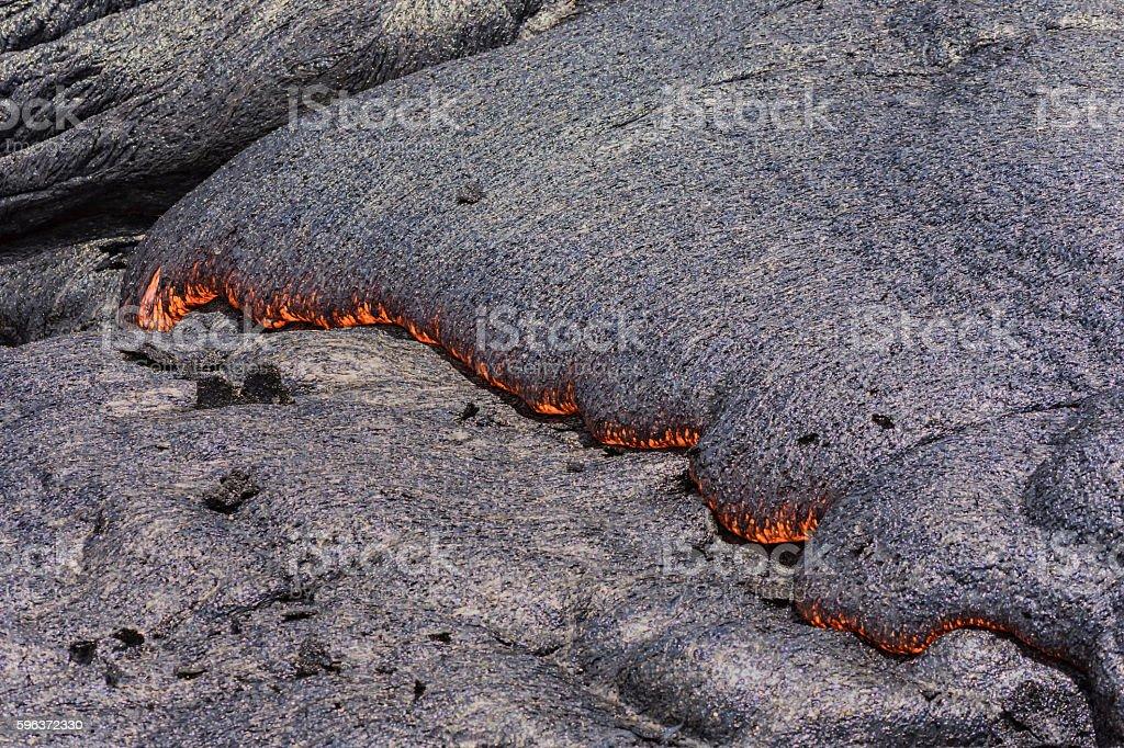 Lava flowing near Puuoo Crater Big Island Hawaii stock photo