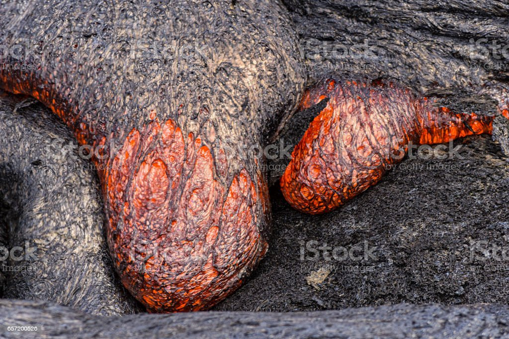 Lava flowing near Puuoo Crater Big Island Hawaii stock photo