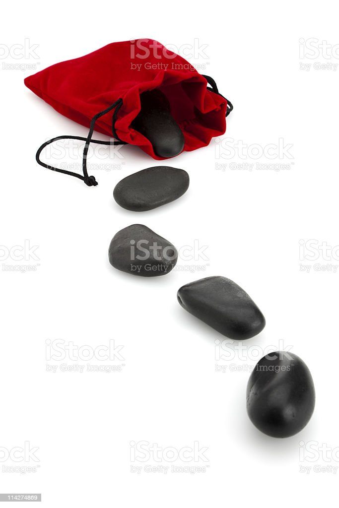 lava massage stones coming from red pouch royalty-free stock photo