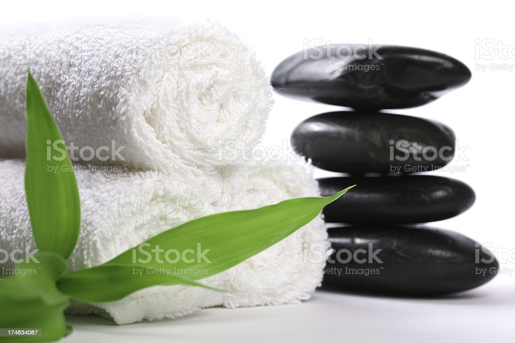 Lava Stones with Towel and Bamboo royalty-free stock photo