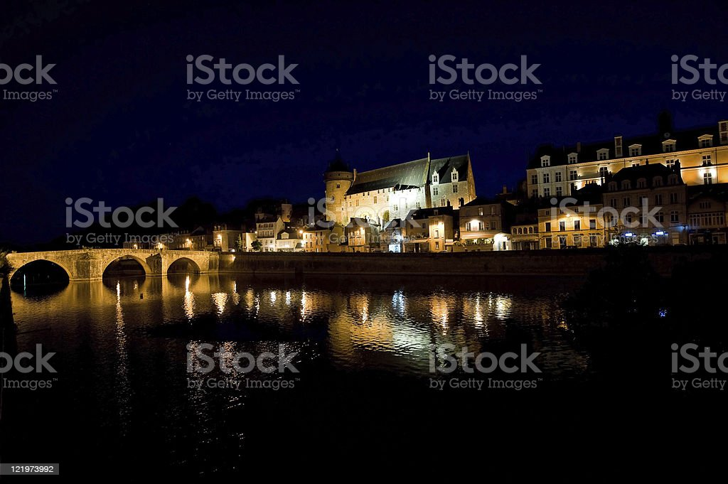 Laval (Loire, France), Ancient buildings on the river by night stock photo