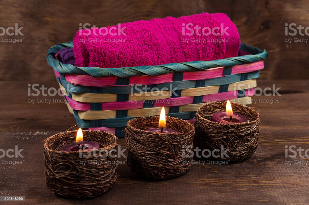 Lavanger Candel in a little basket with towels stock photo