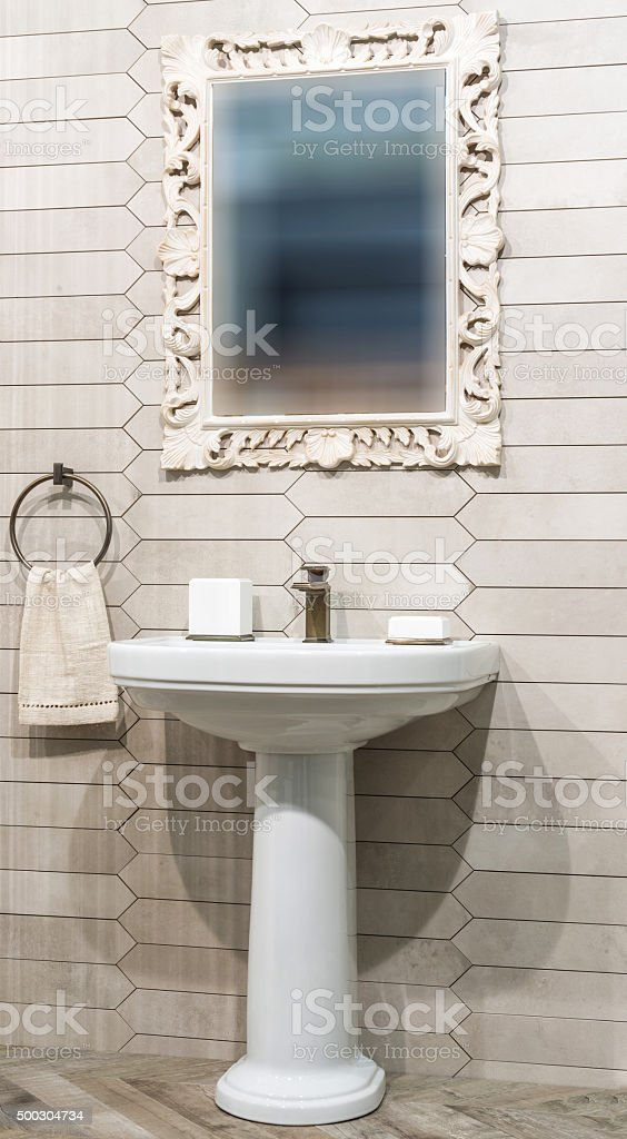 Lavatory and mirror in bathroom interior stock photo