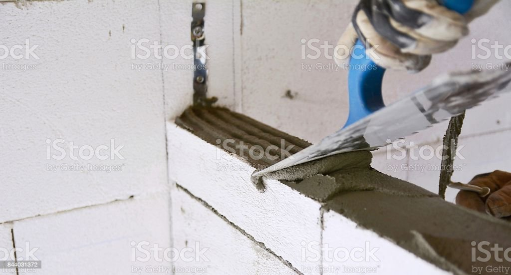 Lavelling a mortar with a trowel stock photo