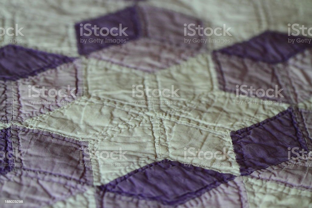 Lavendar and White Quilt stock photo