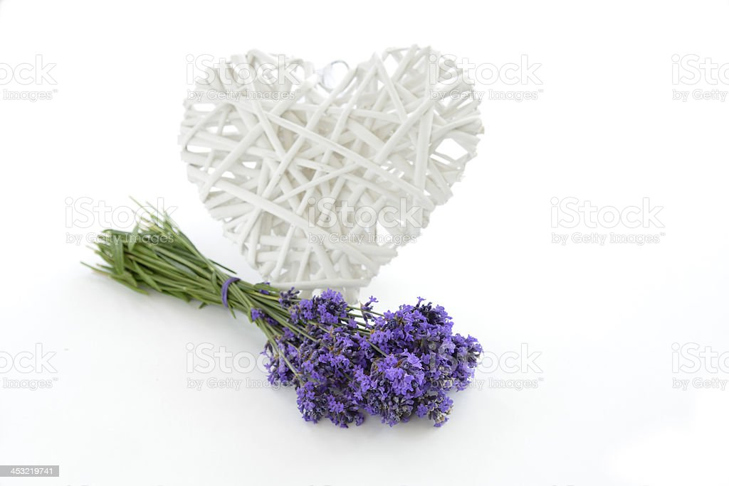 Lavender and wicker heart isolated stock photo