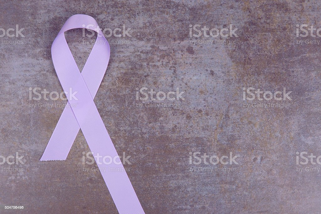 Lavender color ribbon, symbolising awareness for all cancers. stock photo
