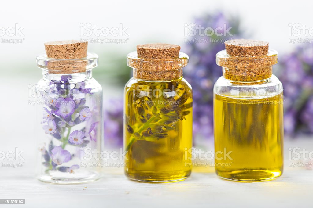 Lavender flowers with essential oil. Spa and wellness concept. stock photo