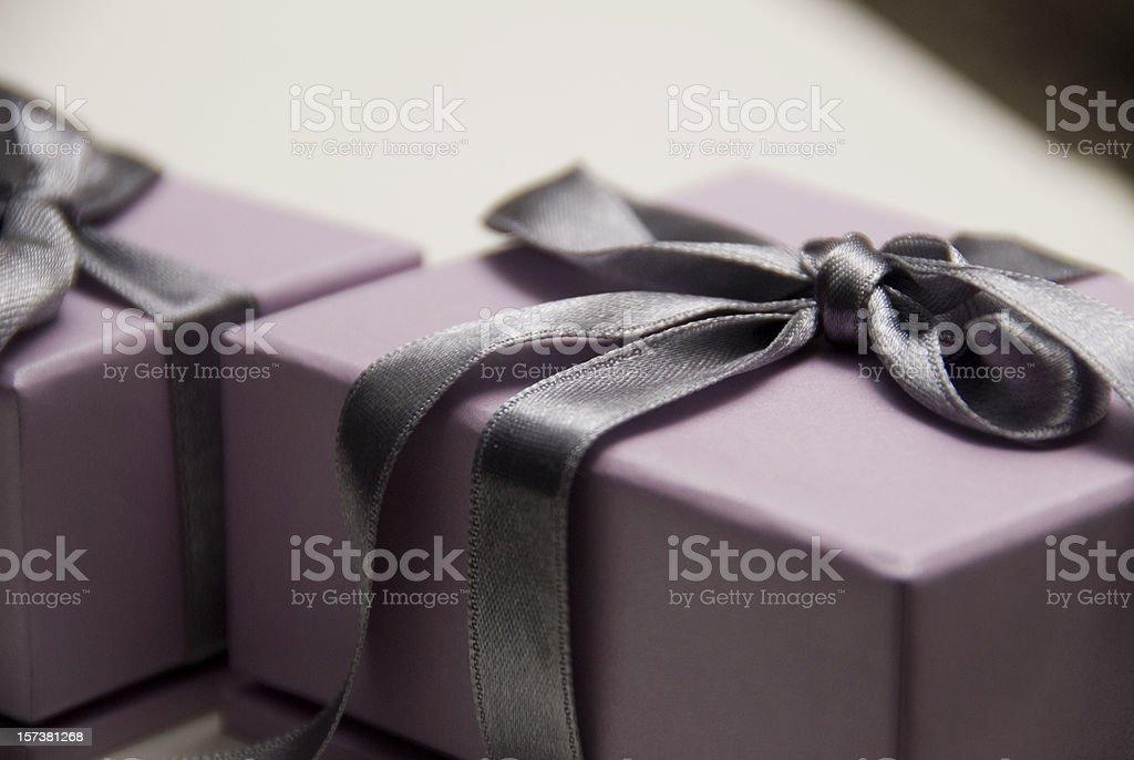 Lavender gift box with a dark purple satin bow stock photo