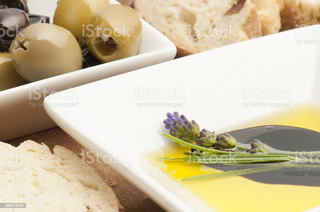 Lavender oil and vinegar with fresh bread and olives royalty-free stock photo