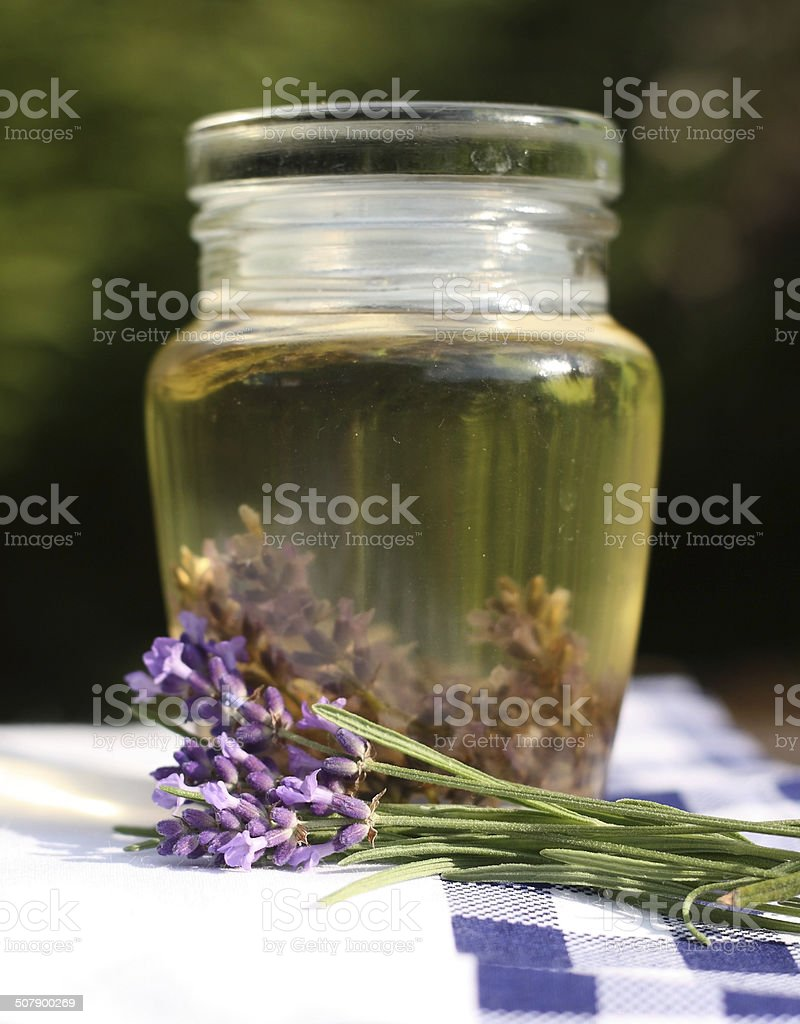 Lavender oil in a glass bottle royalty-free stock photo